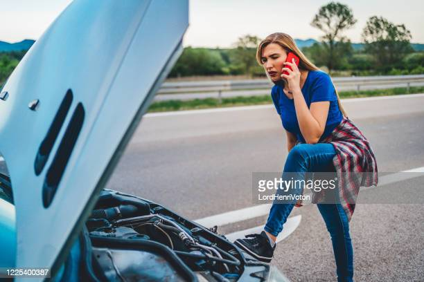 broken car on the road - auto repair shop exterior stock pictures, royalty-free photos & images
