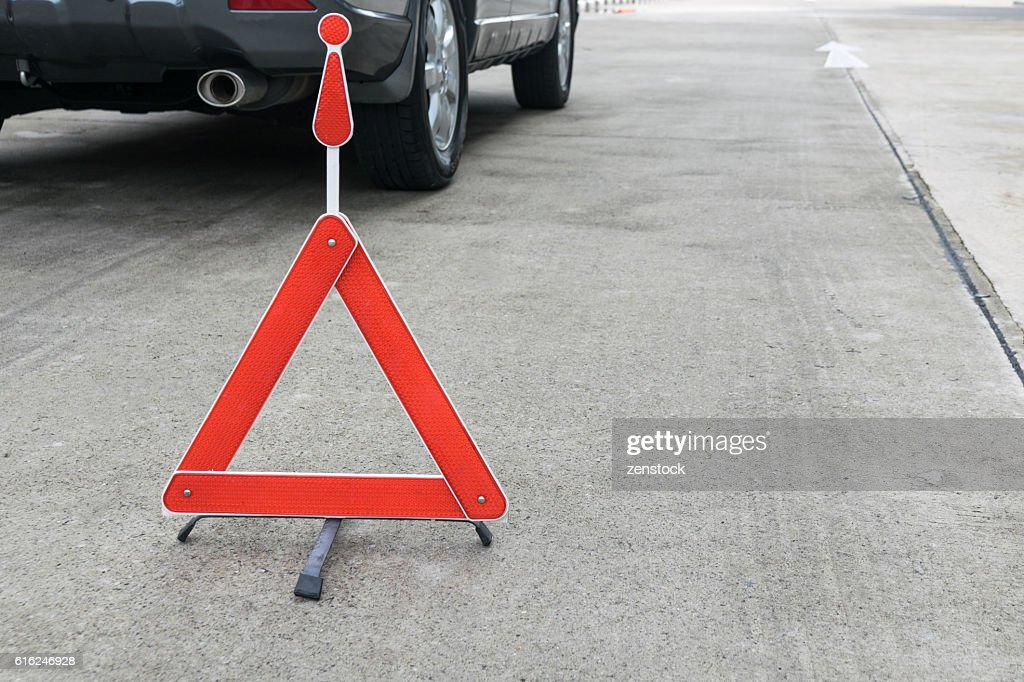 Broken car sign on a road : Stock Photo