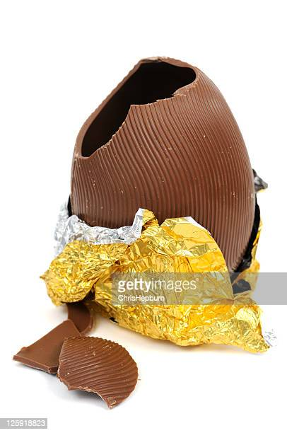 broken chocolate easter egg - easter egg stock pictures, royalty-free photos & images