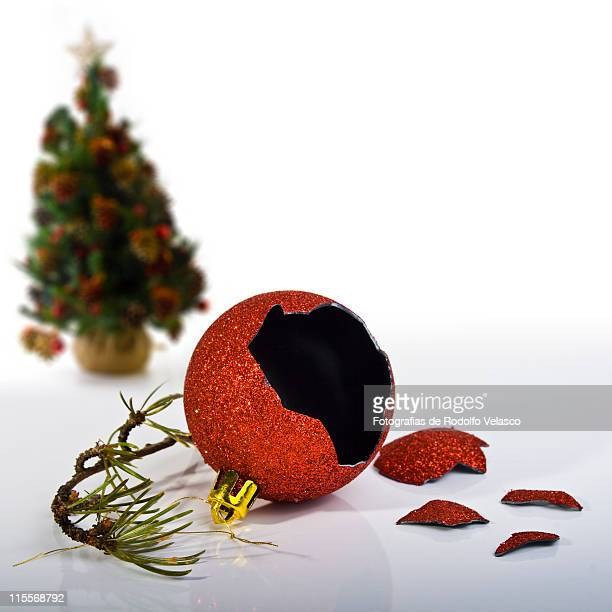 Broken Christmas ball lying on floor
