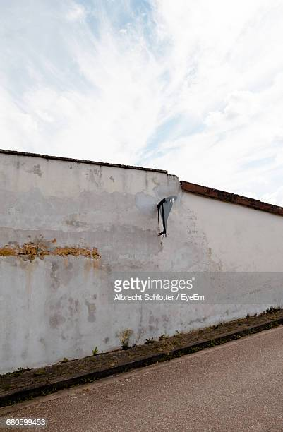 broken concrete wall on roadside - albrecht schlotter stock photos and pictures