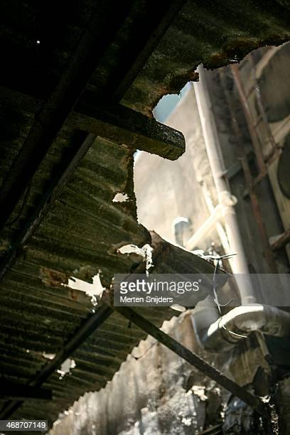 Broken crimp plate roof in alley