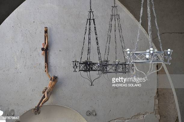 A broken crucifix hanged on the wall of Santa Maria church on August 29 2016 in Accumoli few days after an earthquake hit the area a disaster that...