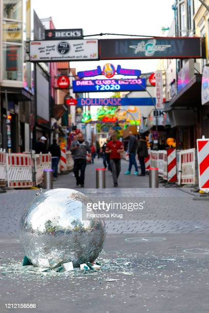 "Broken disco ball in front of ""Grosse Freiheit"", near the Reeperbahn in St. Pauli's Red Light district. Drag queen Olivia Jones leads a protest of..."