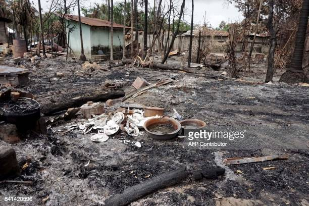 Broken dishes can be seen in the burned out remains of a house in Myo Thu Gyi Muslim village where houses were burnt to the ground near Maungdaw town...
