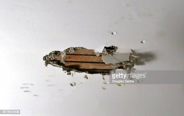 broken drywall on a interior ceiling - ruined stock pictures, royalty-free photos & images