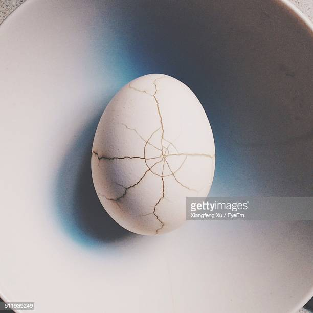 Broken egg on plate