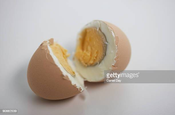 broken eggs - hard boiled eggs stock photos and pictures