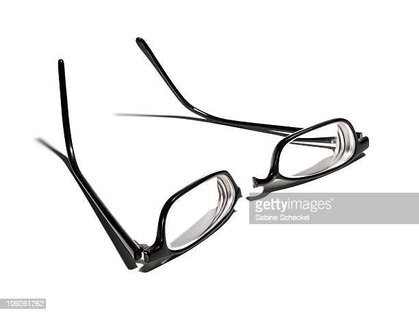broken eyeglasses on white
