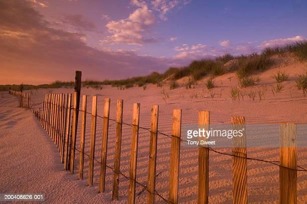 Broken fence line on beach