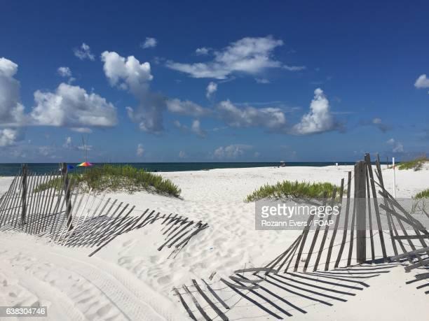 Broken fence on beach
