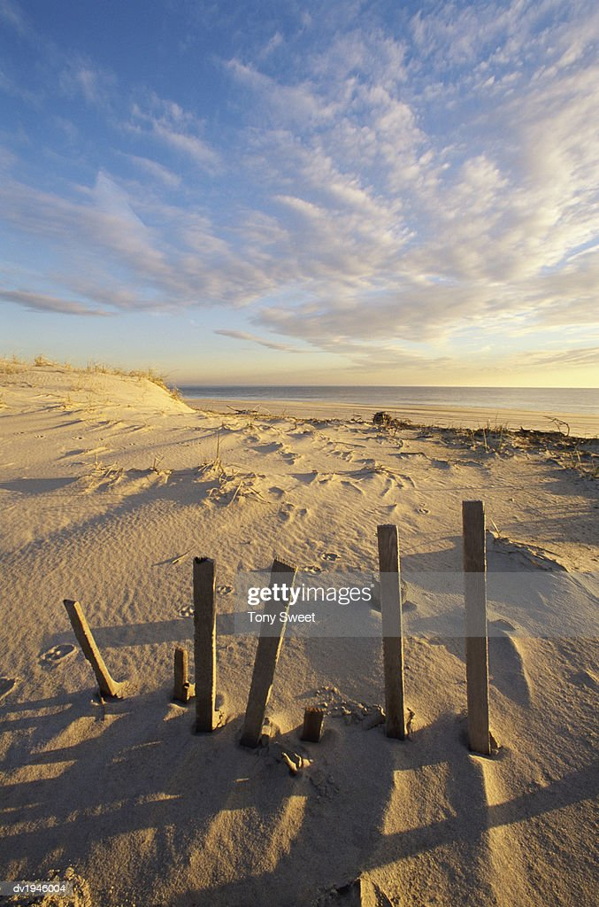 Broken Fence on the Beach at Cape Henlopen, Lewes, Delaware, USA : Stock Photo