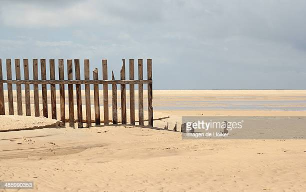broken fence on the beach