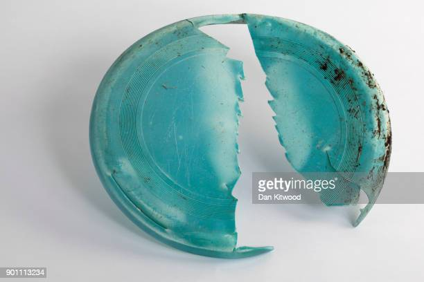 A broken frisby found on the shore of the Thames Estuary on January 2 2018 in Rainham Kent Tons of plastic and other waste lines areas along the...