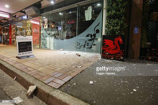 Broken glass and debris covers part of the road on Featherston Street after an earthquake on November 14 2016 in Wellington New Zealand The 75...