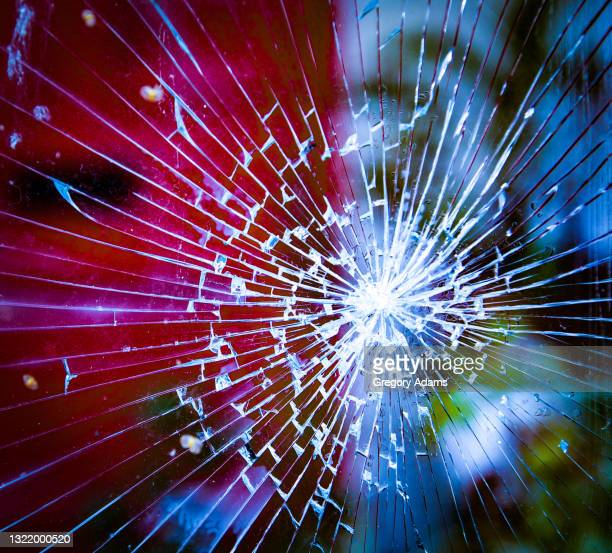 broken glass in a window after a protest - window stock pictures, royalty-free photos & images