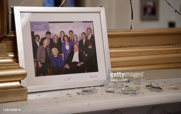 Broken glass litters a mantle as supporters of US President Donald Trump trespass in the office of Speaker of the House Nancy Pelosi as he protest...