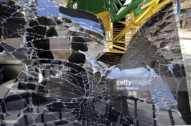 Broken glass mirrors a destroyed shop in the suburb of Haret Hreik August 7 2006 in Beirut Lebanon Israeli jets repeatedly bombed the southern...