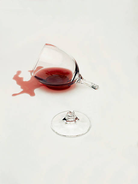 a broken glass of spilled wine pictures getty images