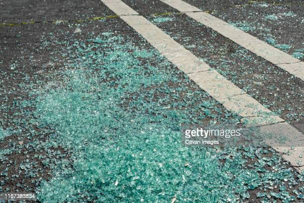 broken glass on ground in parking lot - traffic accident stock pictures, royalty-free photos & images