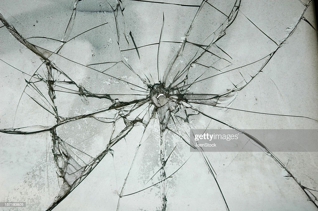 Broken Glass Window Bullet Shooting impact hole cracks : Stock Photo