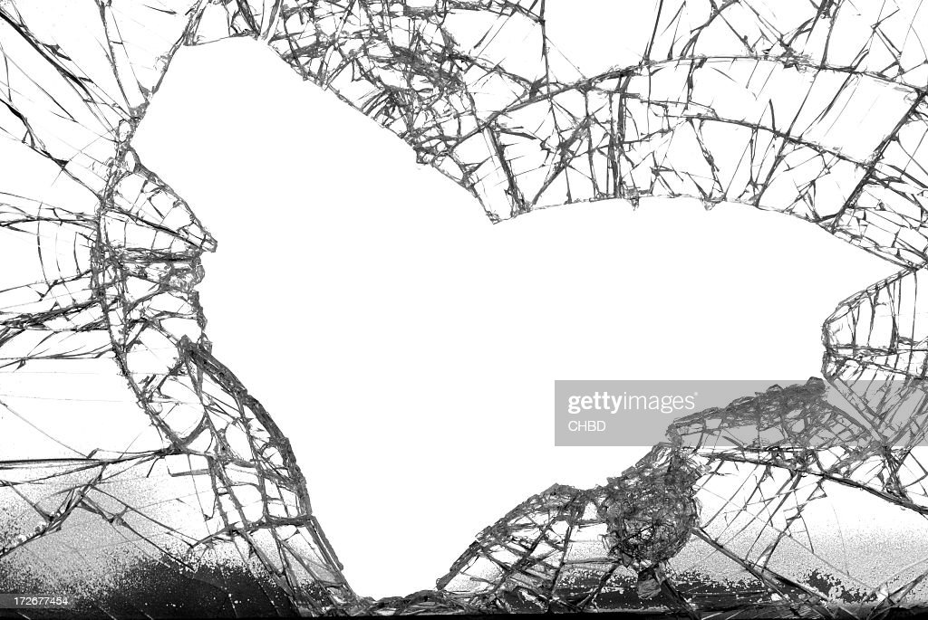 Broken glass with the shape of a heart fallen out : Stock Photo
