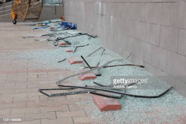 Broken glasses are seen at the scene after a rocket attack outside the international airport in Erbil, the capital of northern Iraqs Kurdish region...