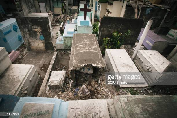 CEMETERY MANILA PHILIPPINES A broken grave seen at the cemetery In the center of Pasay District of Metro Manila is a cemetery where over 10000...