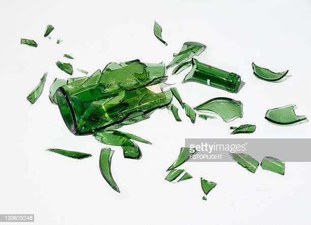Broken green  bottle of wine