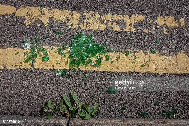 Broken green glass lying in a pile on double-yellow lines in a south London gutter, on 2nd October September 2016, at the National Gallery, London,...