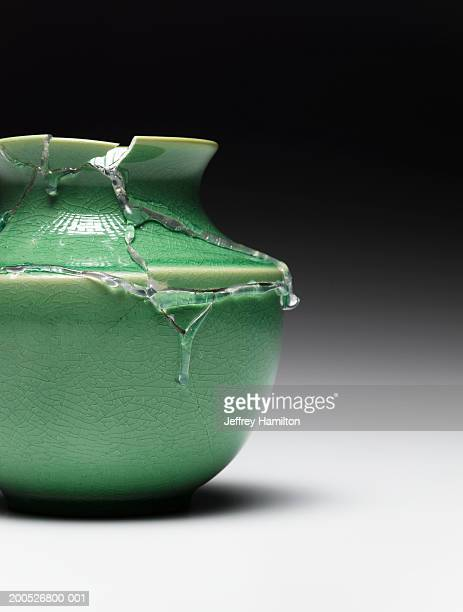 Broken green vase glued together (still life)