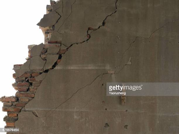 Broken grey wall with bricks,on white background