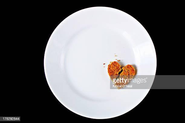 Broken heart cookie on plate