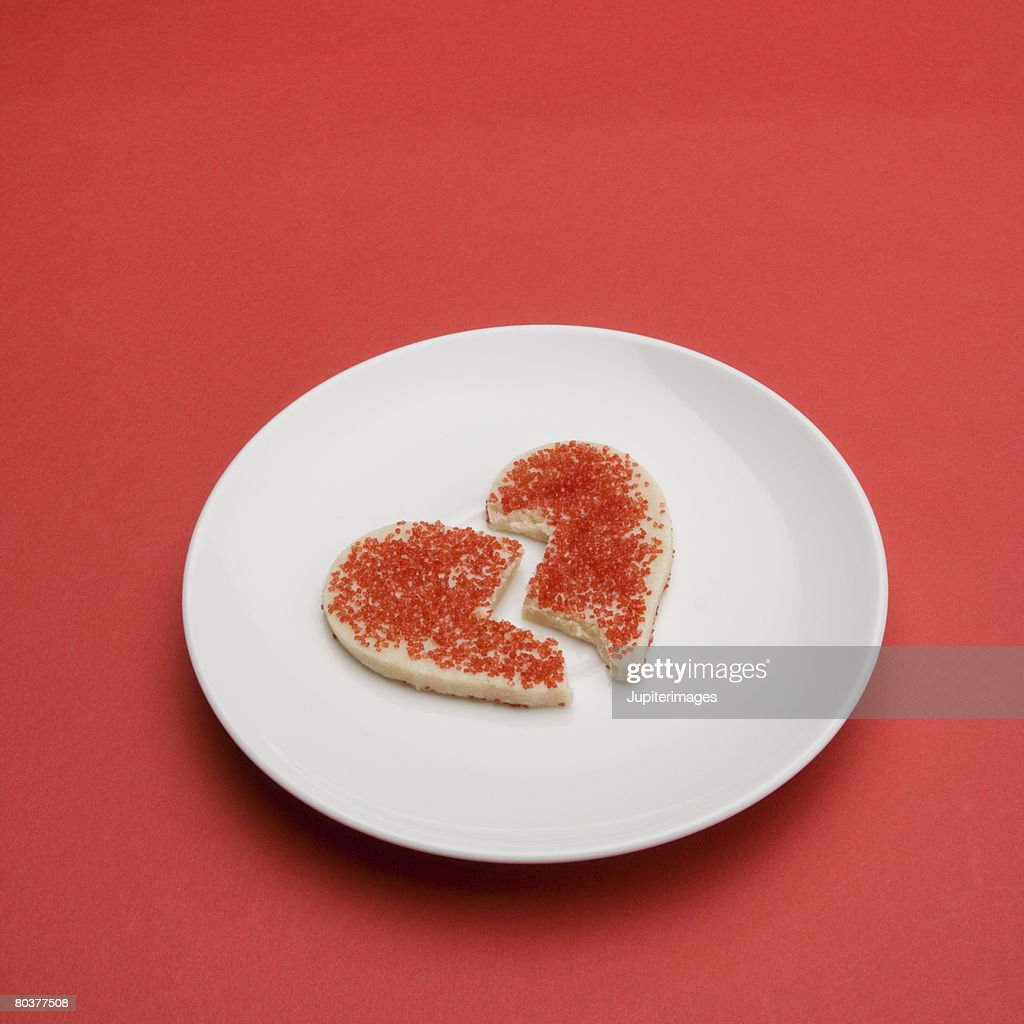 Broken heart cookie on plate : Stock Photo
