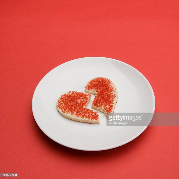 Broken heart cookie on plate
