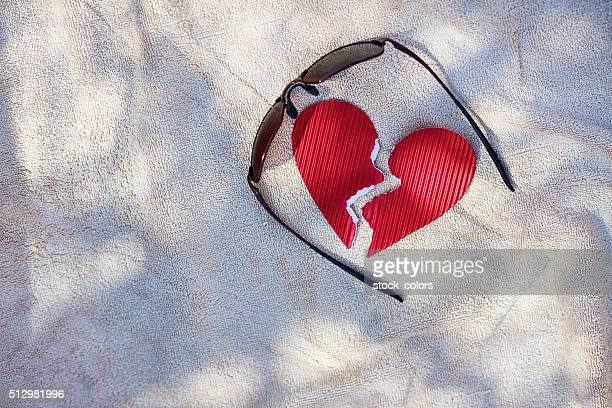 broken heart on sand
