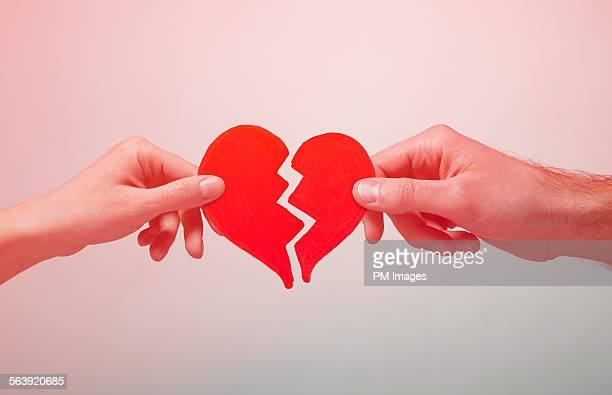broken heart - relationship difficulties stock pictures, royalty-free photos & images