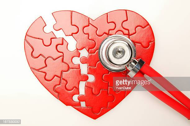 broken heart puzzle with stethoscope - heart disease stock pictures, royalty-free photos & images