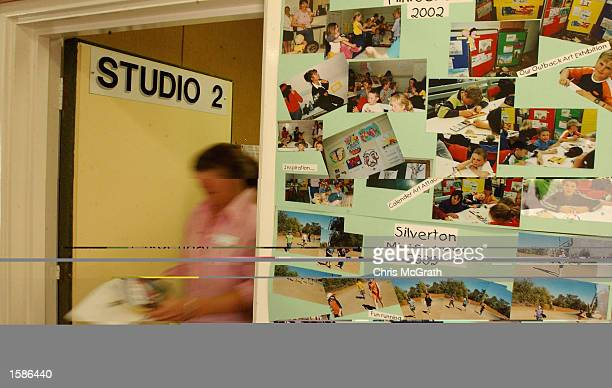 Broken Hill School of the Air grade four teacher Averil Griffith leaves the studio passing pictures of her students after broadcasting a lesson on...