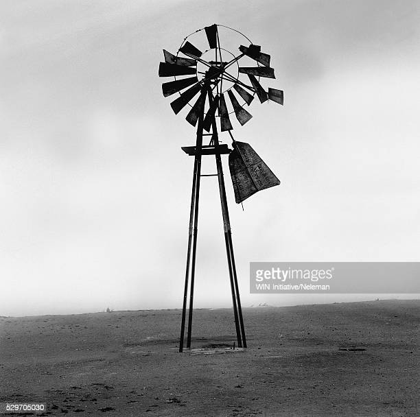 broken industrial windmill on a landscape - old windmill stock photos and pictures