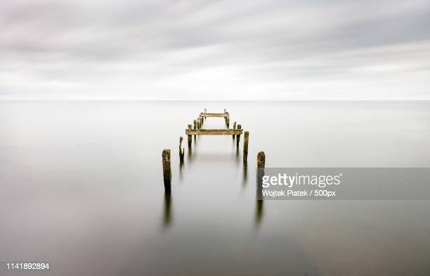broken jetty at lough neagh, northern ireland - piatek stock pictures, royalty-free photos & images