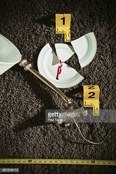 Broken lamp and plate at a crime scene