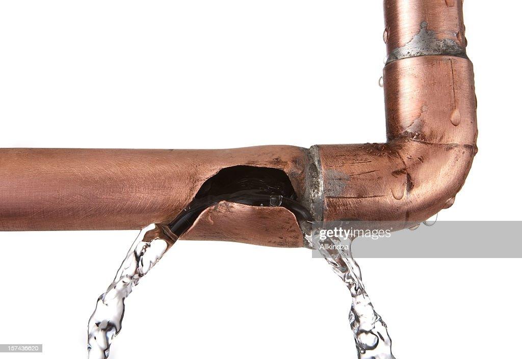 broken leaking copper water pipe : Stock Photo