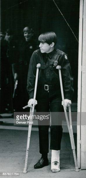 Broken Leg Can't Keep him from performing Lt Charles Moser of the inaugural band who broke his leg highjumping at Carpenter junior high mans flute...