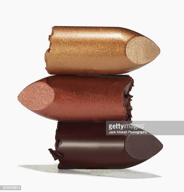 Broken lipstick in a stack