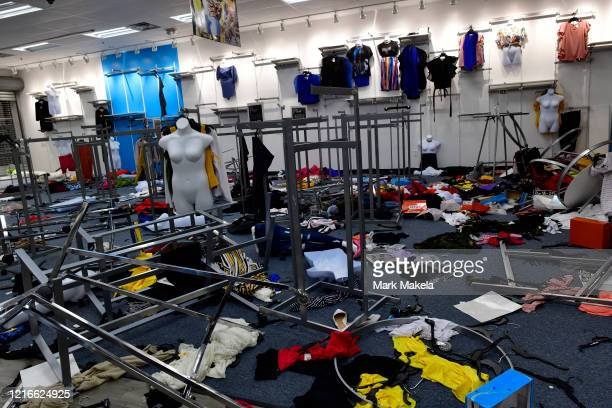 Broken mannequins and clothes lie in disarray during widespread unrest following the death of George Floyd on May 31 2020 in Philadelphia...