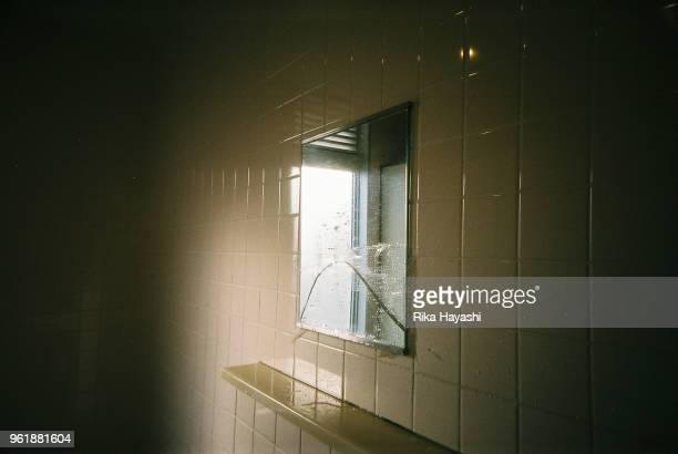 A broken mirror in the toilet beside the seaside