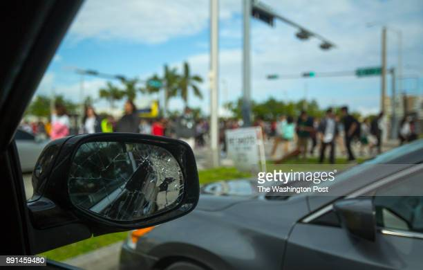 A broken mirror on Larry Johnson's Porsche SUV which he said was destroyed by an angry woman is seen as students leave Jackson Sr High Johnson who...