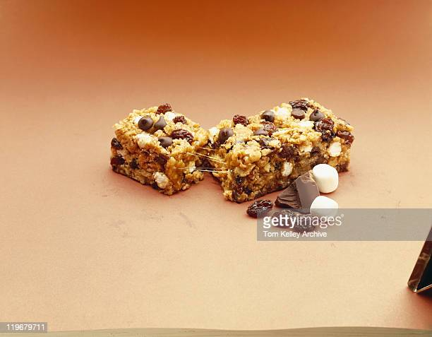 Broken muesli bar on orange background