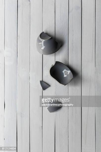 Broken mug on a wooden background